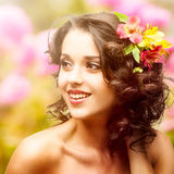 Beautiful young woman over autumn background. Beautiful young woman with flowers in hair over autumn background Stock Photography
