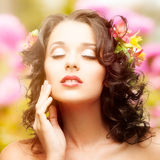 Beautiful young woman over autumn background. Beautiful young woman with flowers in hair over autumn background Stock Photos