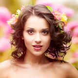 Beautiful young woman over autumn background. Beautiful young woman with flowers in hair over autumn background Royalty Free Stock Images