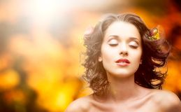 Beautiful young woman over autumn background Stock Photos