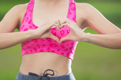 Beautiful young woman over doing a heart shape with her hands. Health campaign concept Royalty Free Stock Photo