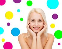 Beautiful young woman over polka dot background Stock Image