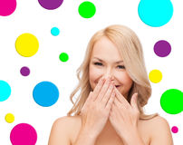 Beautiful young woman over polka dot background Royalty Free Stock Image
