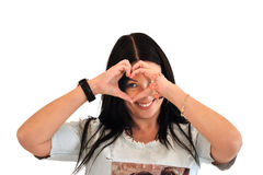 Beautiful young woman over white background doing a heart shape with her hands Royalty Free Stock Images