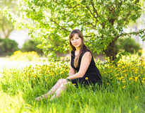 Beautiful young woman over white blossom tree, outdoors portrait Royalty Free Stock Photo