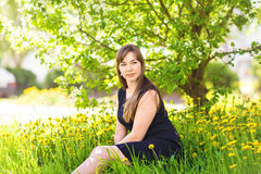 Beautiful young woman over white blossom tree, outdoors portrait Stock Images