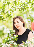 Beautiful young woman over white blossom tree, outdoors portrait.  Stock Image