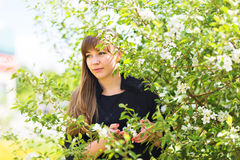 Beautiful young woman over white blossom tree, outdoors spring portrait Royalty Free Stock Photography