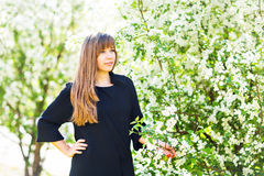 Beautiful young woman over white blossom tree, outdoors spring portrait Royalty Free Stock Photo