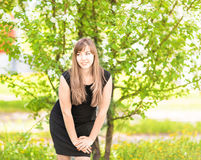 Beautiful young woman over white blossom tree, outdoors spring portrait Stock Photos