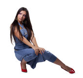 Beautiful young woman in overalls Stock Image