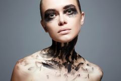 Beautiful Young woman with Paint Face. Halloween style makeup Girl stock photo