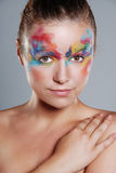 Beautiful young woman with painted makeup Royalty Free Stock Photography