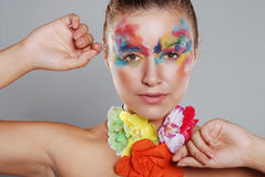 Beautiful young woman with painted makeup Stock Photos