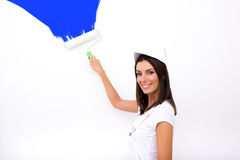 Beautiful young woman painting a Apartment Royalty Free Stock Photography