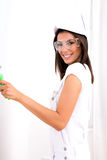 Beautiful young woman painting a Apartment Stock Photo