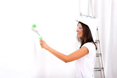 Beautiful young woman painting a Apartment Royalty Free Stock Photos