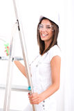 Beautiful young woman painting a Apartment Stock Image