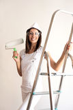 Beautiful young woman painting a Apartment Stock Photography