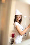 Beautiful young woman painting her Apartment Royalty Free Stock Photo