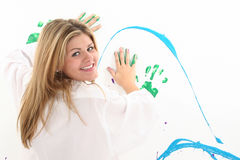 Beautiful Young Woman Painting on Wall stock image