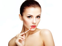 Beautiful young woman paints lips with lipstick. Perfect make-up Royalty Free Stock Photos