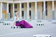 Beautiful young woman in Palais Royal Royalty Free Stock Photography