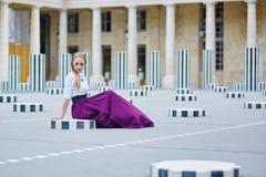 Beautiful young woman in Palais Royal Stock Photo
