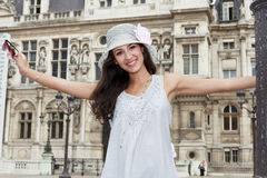 Beautiful Young Woman in Paris. Beautiful young woman in a fashion pose in a plaza in Paris, France with typical French architecture in the background royalty free stock photos