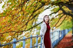 Woman in Paris on a bright fall day Royalty Free Stock Image