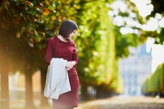Woman in Paris on a bright fall day Royalty Free Stock Photo