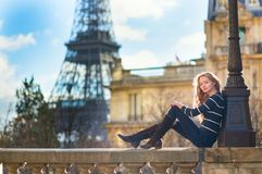 Beautiful young woman in Paris stock images