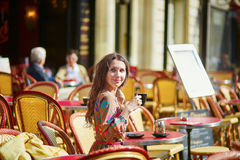 Beautiful young woman in a Parisian cafe Royalty Free Stock Photo