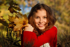 Beautiful young woman in park Stock Photography