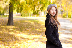 Beautiful young woman in the park Royalty Free Stock Image