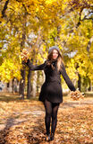 Beautiful young woman in the park Stock Photography