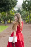 Beautiful young woman in the park royalty free stock photo