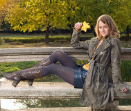 Beautiful young woman in the park at fall. Royalty Free Stock Photo