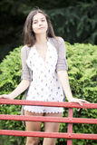 Beautiful young woman in the park royalty free stock photography