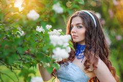 Beautiful young woman in a park in spring lilac Royalty Free Stock Photography