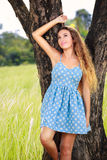 Beautiful young woman in park Stock Photos