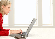 Beautiful Young Woman Paying Bills Online Stock Image