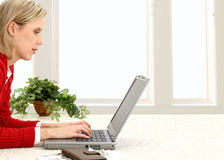 Beautiful Young Woman Paying Bills Online Royalty Free Stock Photography
