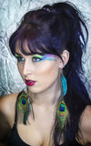 Beautiful young woman in peacock makeup Stock Images