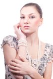 Beautiful young woman with pearls jewelery Royalty Free Stock Photos