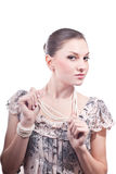 Beautiful young woman with pearls jewelery Royalty Free Stock Images