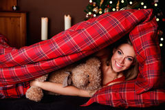 Beautiful young woman peeking out of the blanket Royalty Free Stock Photos
