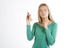 Beautiful young woman with pen Royalty Free Stock Image
