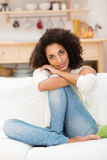 Beautiful young woman in a pensive mood Stock Photography
