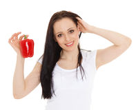 Beautiful young woman with a pepper. Stock Image